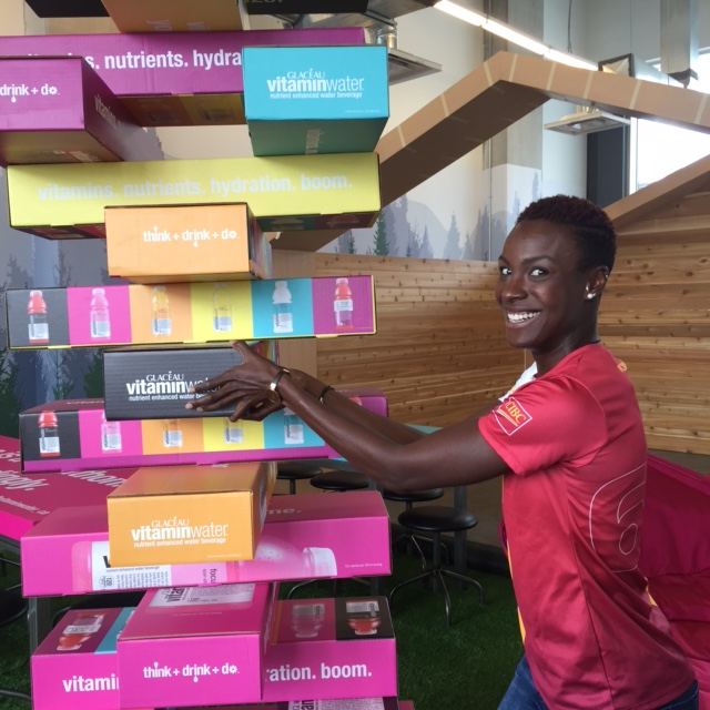 Kim playing with the life-size Jenga in the Vitamin Water Cabin